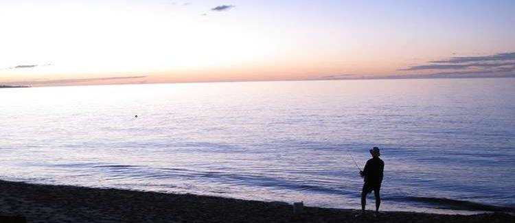 Beach fishing on a warm summer's evening in Hervey Bay