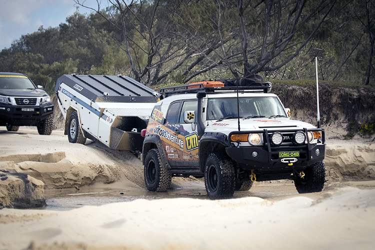 Beach driving on Fraser Island is not as easy as you might think. Here we see some experienced 4wd campers crossing one of the many streams that cuts deep gutters in the sand as they run into the ocean.