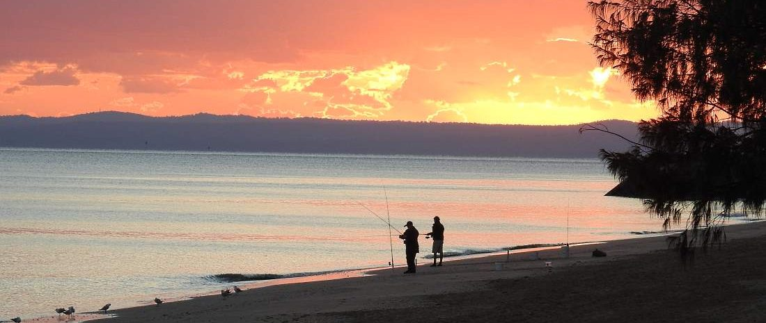 Fishing off the beach at sunrise in Hervey Bay